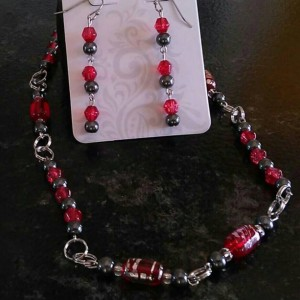 Red and gray beaded necklace, 11.5 inches long with matching stainless steel, hypoallergenic earrings.