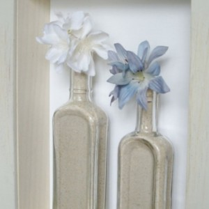 Apothecary Shadow Box Antique Glass Bottles with White & Periwinkle Flower Display