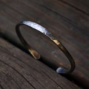 Silver cuff bracelet with rivets