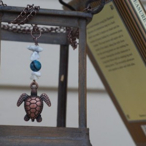 Handmade Bronze Sea Turtle Necklace with White Stones and Blue Beads