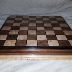 Chessboard made from walnut,birdseye maple,and ebony with 2 and a quarter inch squares