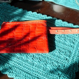 Bright Red Cowhide alligator print 2 pocket clutch purse with gold rivets on handle