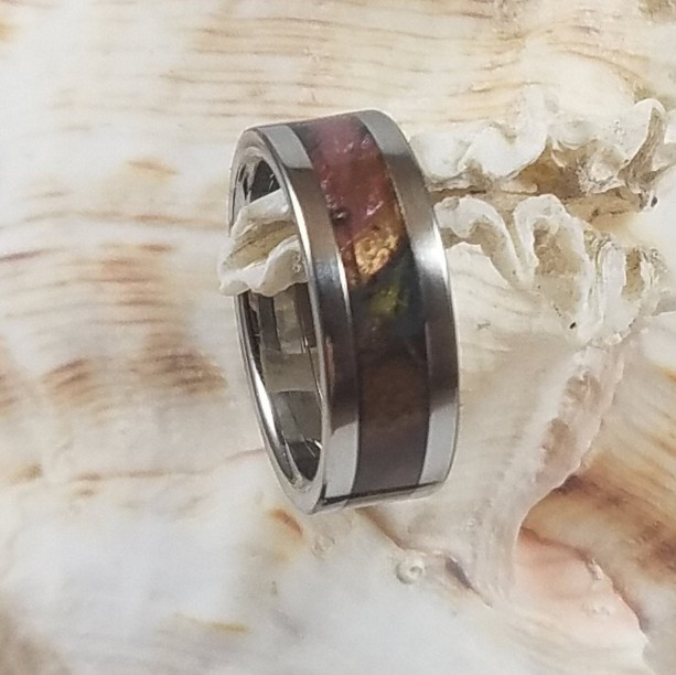 size 4 burl and resin ring around a stainless steel core with stainless steel accent edges 6 mm wide band