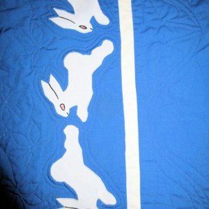 Baby Crib Quilt with White Rabbits on a Blue Background