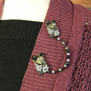 Vintage style black and pearl green sweater keeper with rhinestones and glass beads