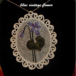 "FSL embroidered vintage flower necklace. Pat attached her vintage flower design onto a 9"" silver chain purchased from Hobby Lobby."