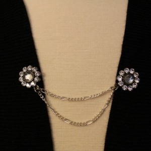 Rhinestone and silver chain sweater pin