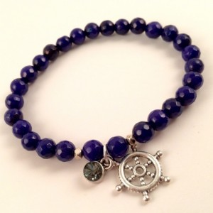 Blue jade bracelet with ship helm charm