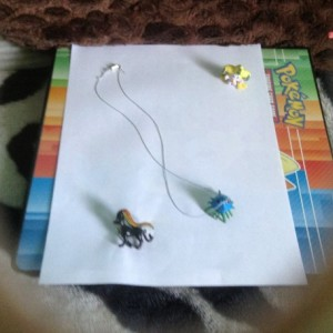 jirachi and Pyroar Pokemon pins Bonus Tentacruel Necklace