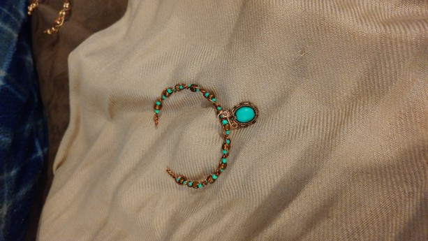 Woven wire pendant with turquoise dyed accent