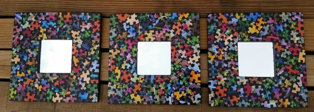 Set of Mirrors Framed by a Mosaic of Puzzle Pieces