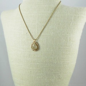 Bronze with Natural Gold Rutilated Quartz Pendant