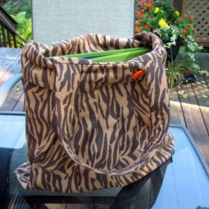 Zebra print pleated hobo style bookbag / tote with orange interior pocket organizer