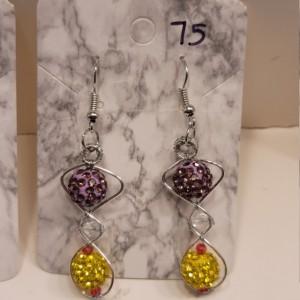Figure 8 design with purple and yellow rhinestone beads