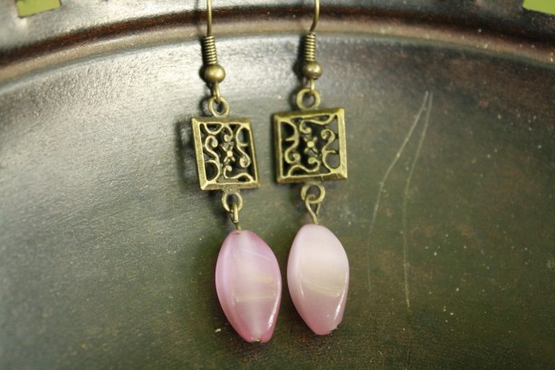 Vintage-inspired earrings with pink accent stone