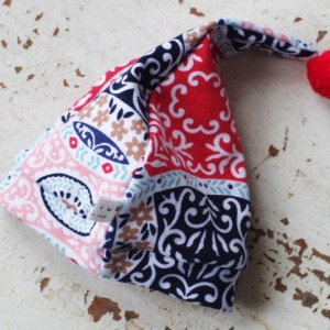 0-3 mo Elf - Hobbit - Gnome - Dwarf Hat with PomPom Tail. Newborn hat in Medallion print multicolored fabric.