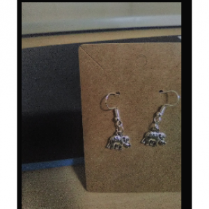 Elephant cham earrings.