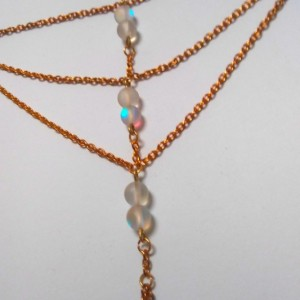 Gold and Opalized Glass Hand Chain