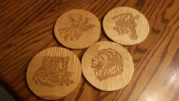 Safari Animal Hand Made Wooden Coaster Set. Clear coated Curly Maple