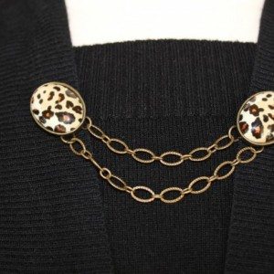 Sweater keeper with two bronze leopard cameos connected by two small bronze chains