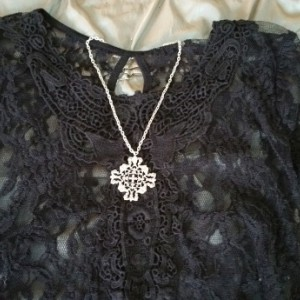 Silver cross pendant on chain.