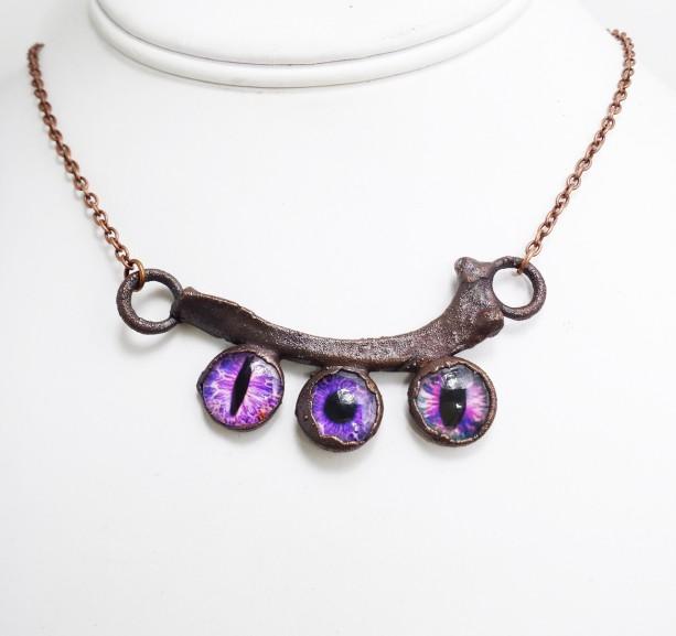 Rib Bone with Purple Eyes Necklace