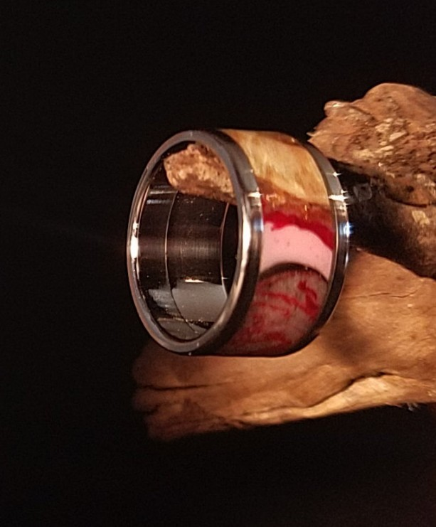 Size 4 3/4 Maple burl ring, Stainless Steel core and outer edges, red, pink, and black resin highlights