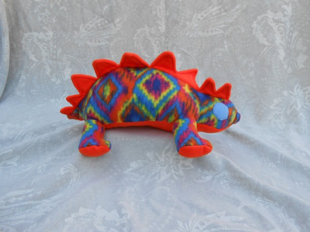 Rainbow Pattered Small Stegosaurs Dinosaur With Neon Orange Accents