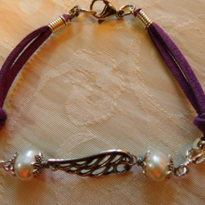 Natural purple leather and silver tone angel wings bracelet and earrings matching set design.  #BES00121