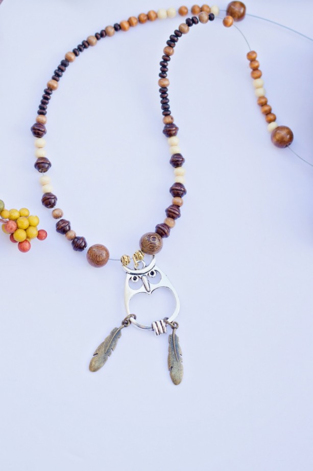 Owl silver pendant charm necklace/Various light and dark wood beads, gold metal spacers and gold feather charms/Under 20 dollars/Nickel free