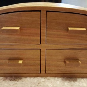 Jewelry box made of cherry and plywood with maple drawer pulls