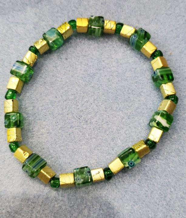 green milliflori and gold bracelet