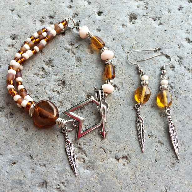 Brown and cream glass and feather bracelet with arrow toggle and matching earrings