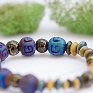 Boho bohemian stretch bracelet/Blue ceramic stone,rubber coated black beads/Various wooden beads/Nickel free/Under 20 dollars