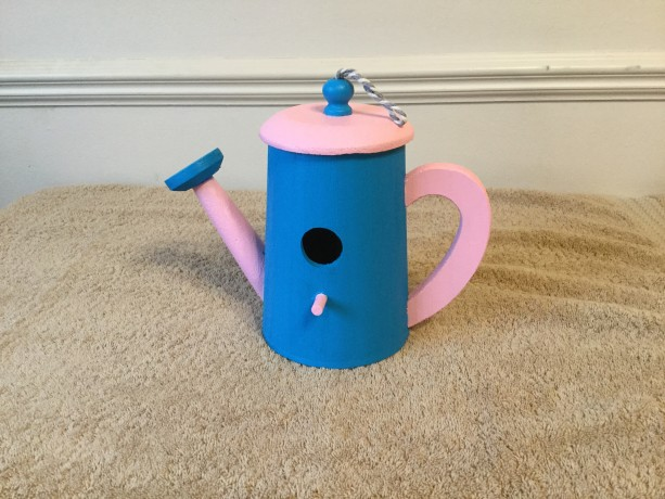 Birdhouse watering can