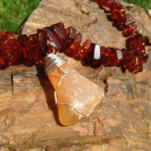 Baltic amber beaded necklace with polished druzy agate