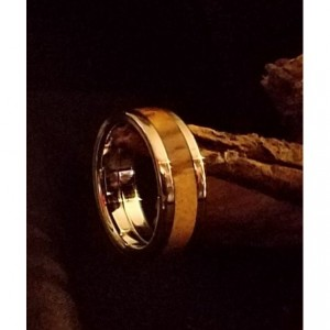 7 1/2 Stainless steel core and accent edges with the center of a pinecone supplying the wood. 6mm wide