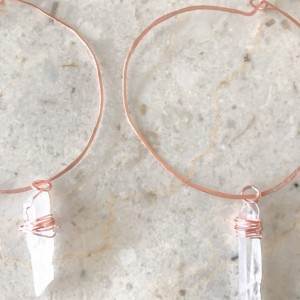 hand-hammered hand wrapped copper hoops with wrapped Quartz crystal