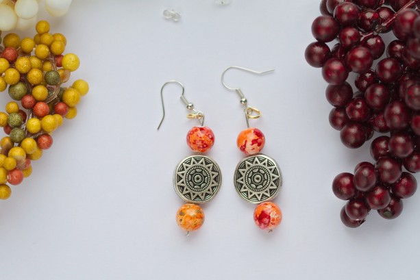 Antique silver sun bead with Fall orange and red color bead earrings/Under 20 dollars
