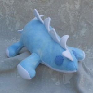Mottled Light Blue Stegosaur Dinosaur with White Accents