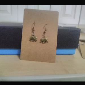 Elephant cham earrings.