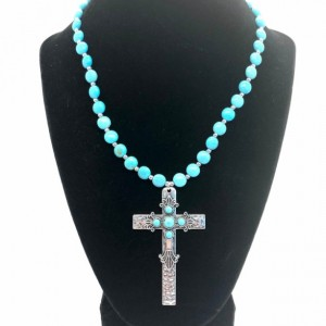 Southwestern Turquoise colored necklace with hammered cross pendant