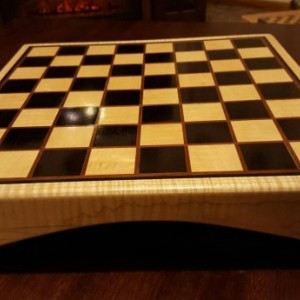 Chessboard made with quilted maple and gaboon ebony with ipe inlays