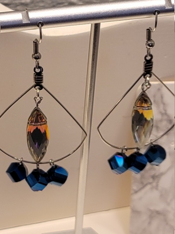 Stainless steel with blue bead and multi colored center crystal earrings