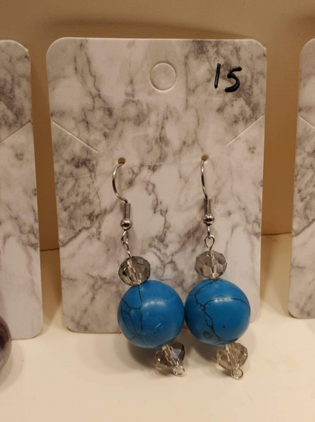 Blue bead with black veins and clear colored bead earrings