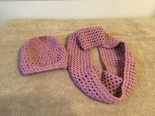 Crocheted cowl and messy bun/ponytail hat