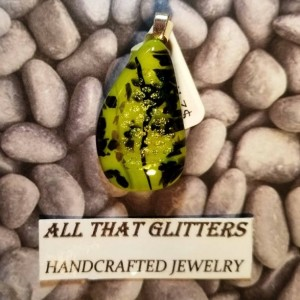 Dichroic Pendant on green background with black swirls and gold accents with sterling silver finding. Great gift idea for any occasion.