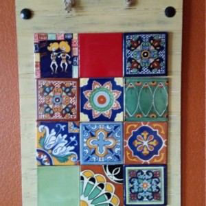 Rustic, handmade wooden wall hanging with Talavera tile accents