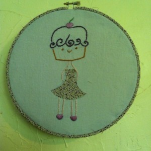 Hoop art embroidery. Cupcake girl wearing a dress