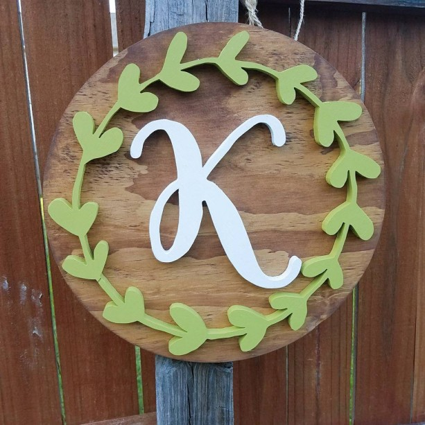 14 inch round wood initial sign with greenery